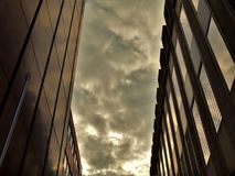 Two Black High-rise Buildings Under Gray Cloudy Sky Stock Image