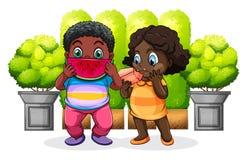 Two black kids eating Stock Photos