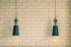 Lampshade on a brick wall background stock photos
