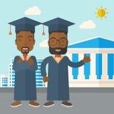 Two black men wearing graduation cap Stock Image