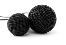 Two black microphones. Isolated on a white background Royalty Free Stock Photos