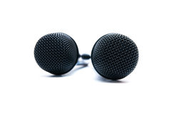 Two black microphones on a white background Royalty Free Stock Image