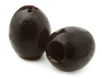 Two black olives. Against white background stock photo