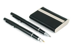 Two black pens and visiting cards Stock Image