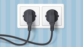 Two black plug inserted in a wall socket on backdrop of wall with wallpaper with stripes. The plug is plugged into the. Power lines with electric cord. Icon of Stock Photo