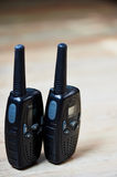 Two black professional portable radio sets with maps Stock Images