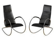 Two black rocking chair on a white background 3d rendering. Two black rocking chair on a white background 3d vector illustration