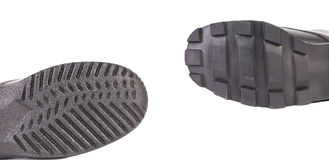 Two black shoe soles. Stock Images