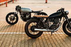 Two black and silver vintage custom motorcycles cafe racers Stock Photography