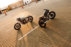 Two black and silver vintage custom motorcycles cafe racers stock photos