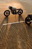 Two black and silver vintage custom motorcycles cafe racers Stock Image