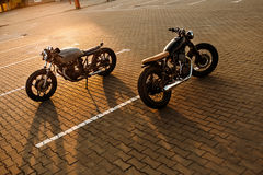 Two black and silver vintage custom motorcycles cafe racers royalty free stock image