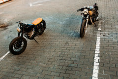 Two black and silver vintage custom motorcycles cafe racers Royalty Free Stock Photo