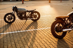 Two black and silver vintage custom motorcycles caferacers Royalty Free Stock Photo