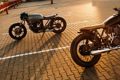 Two black and silver vintage custom motorcycles caferacers Stock Images