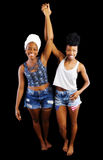 Two Black Sisters Standing Together Shorts Tops Head Scarves. Two Black Women Standing Shorts Tops Head Scarves Stock Photo