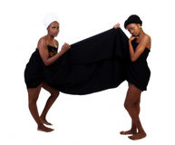 Two Black Sisters Standing Wrapped In Cloth. Two African American Woman Standing Wrapped In Cloth Stock Image