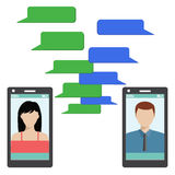 Two black smartphones with blank speech bubbles. Royalty Free Stock Photo