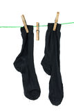 Two black socks hanging on rope Stock Photography