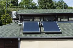 Solar panels on green roof on house in nature royalty free stock photo