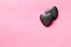 Two black stone hearts Stock Images