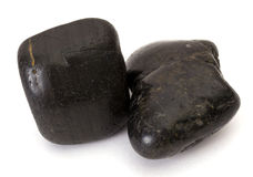 Two black stones isolated. On white background Royalty Free Stock Photos