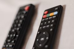Two TV remote controllers stock photography
