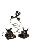 Two black vintage telephones entangled Royalty Free Stock Images
