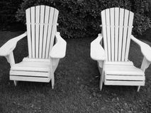 Two Black and White Adirondack Chairs. In Maine, USA royalty free stock image
