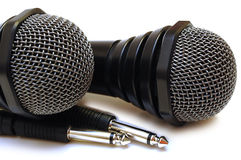 Two Black Wired Karaoke Microphones. Stock Images