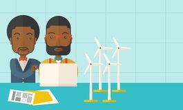 Two black Workers using laptop with windmills. A two black workers using laptop with windmills as power generator. A Contemporary style with pastel palette, soft Stock Images