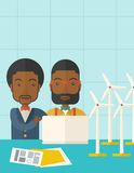 Two black Workers using laptop with windmills. A two black workers using laptop with windmills as power generator. A Contemporary style with pastel palette, soft Stock Image