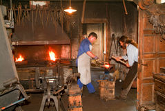 Two blacksmith working in the smithy at Ballenberg Royalty Free Stock Images