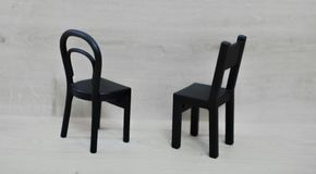 Two blackwooden empty chairs . royalty free stock images
