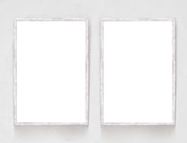 Two blank banners with wooden frame on plaster wall background Royalty Free Stock Photo