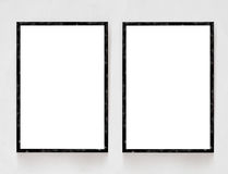 Two blank banners with wooden frame on plaster wall background.  Royalty Free Stock Photos