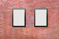 Two blank billboards attached to a buildings exterior brick wall Stock Photo