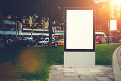 Two blank billboards with copy space for your text message or promotional content, public information boards in urban setting in e Stock Photography