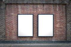 Two blank boards. Two blank billboards attached to a buildings exterior brick wall Royalty Free Stock Photos