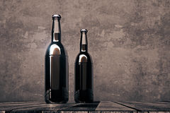 Two blank bottles on dark background Stock Images