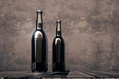 Two blank bottles on dark background. Two blank beer bottles placed on wooden desk on dark concrete background. Alcohol drink beverage logo advertisement concept Stock Images