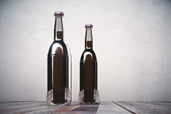 Two blank bottles on light background. Two blank beer bottles placed on wooden desk on light concrete background. Alcohol drink beverage logo advertisement Royalty Free Stock Images