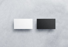 Two blank business card mockups  on grey textured Royalty Free Stock Photos