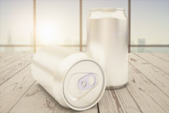 Two blank cans on desk Stock Images