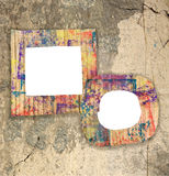 Two blank colorful painted cardboard frames on wall Stock Images