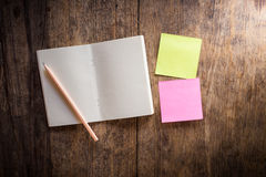 Two blank colorful sticky notes and notebook and pencil Stock Photos