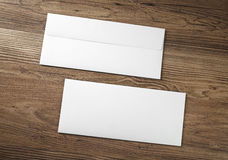 Two blank envelopes. On wood table background. Front and back side stock photo