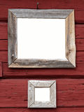 Two blank framed signs. On old wooden wall stock photography