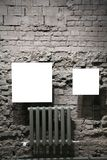 Two blank frames on grey brick wall Royalty Free Stock Photo