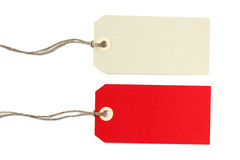 Two blank gift tags - isolated. Two blank gift tags in grey and red - isolated on white background Stock Photo